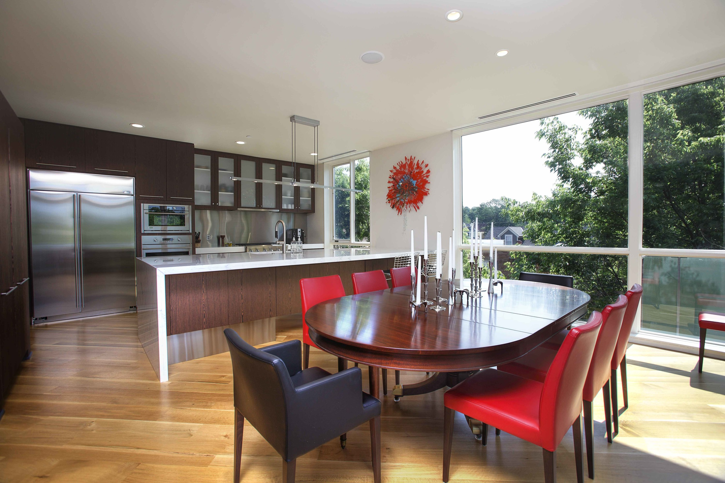 """The cabinets in this Hyde Park condo are """"skinned"""" in Tree Frog veneer, which is both exotic, sustainable and a qualifying point for LEED certification."""