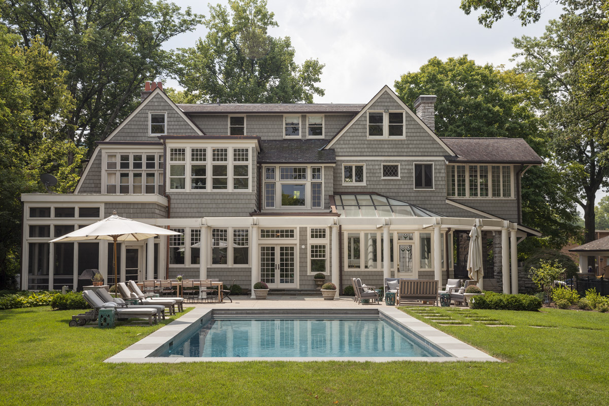 """When we sold these wonderful client's their dreamy Hyde Park """"cottage"""" the pool that came with it was DOA. We dug it out, re-graded, and moved the poll to a centered location for optimal sight lines and buttloads of family fun."""