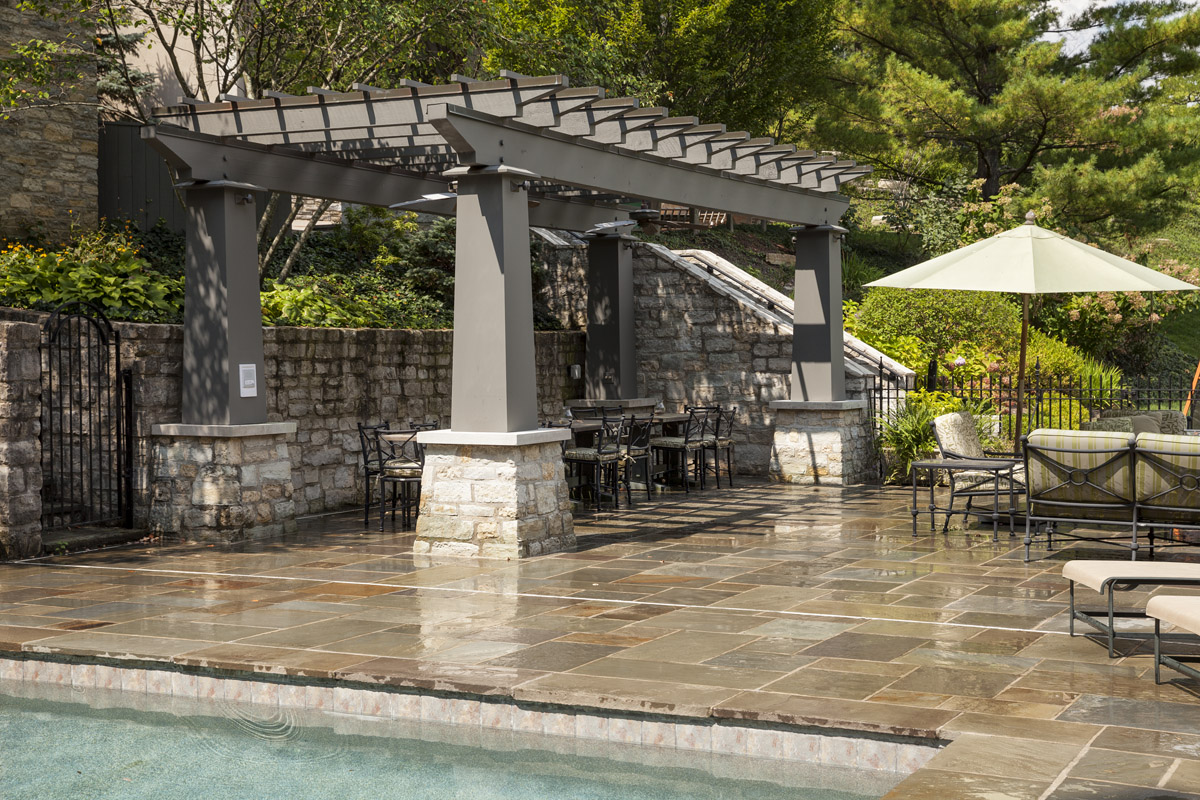 These clients wanted a place to dine alfresco, but also wanted to give the dining areas it's own sense of place. We designed this open air pergola to compliment the architecture of their home and set it (and them!) apart.