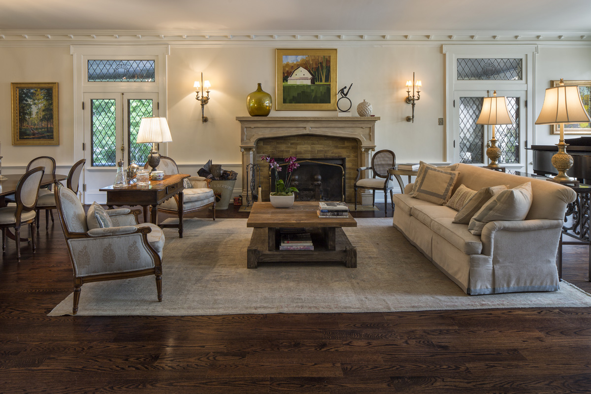 The paneling in this room was dark stained wood, which was impressive but foreboding. Don't be afraid to paint your paneling. Your life will be brighter for it.