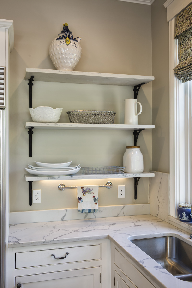 These open shelves made from the same quartz stone as the counter-top and back-splash created a functional focal point in this kitchen.