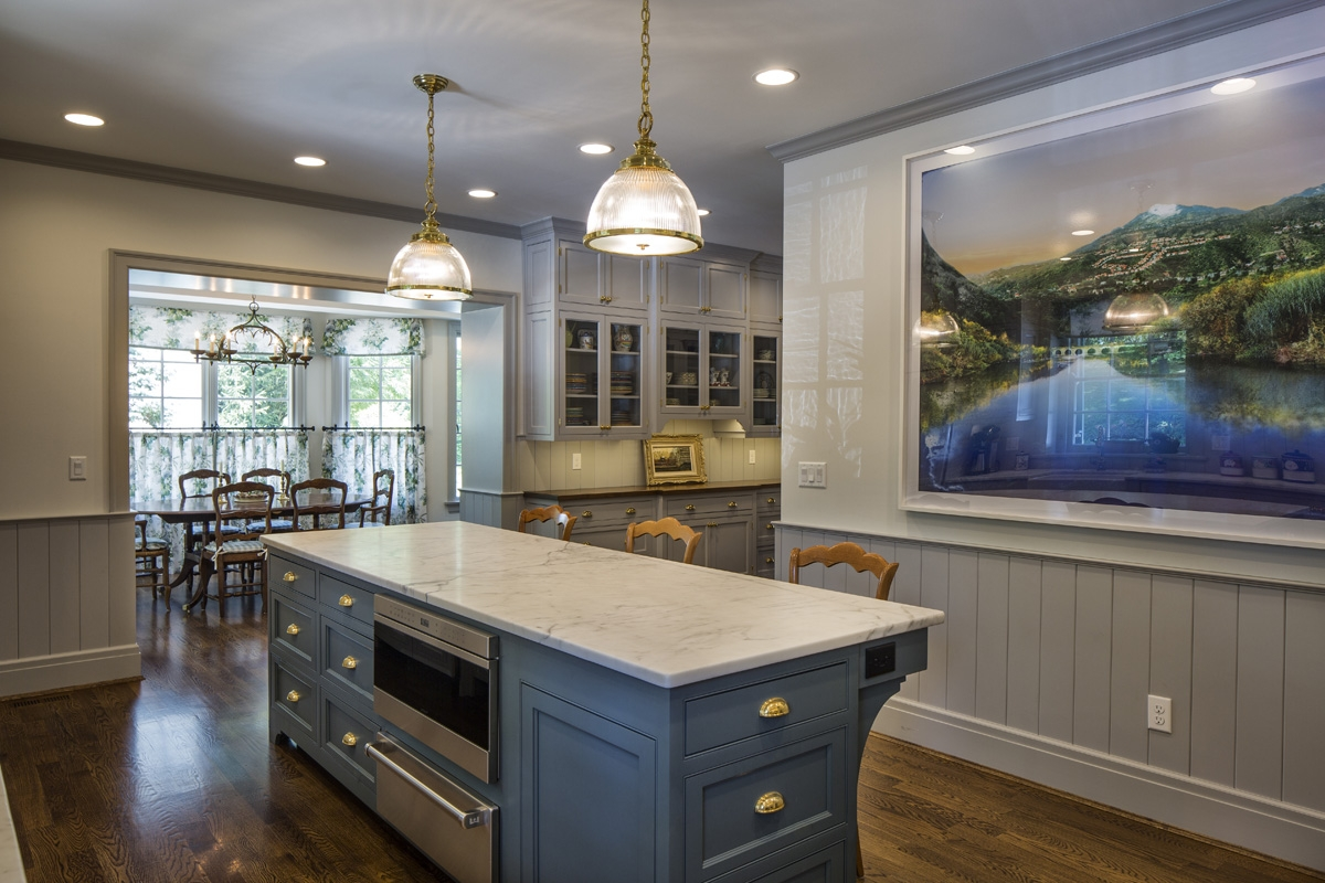 Prior to this renovation this kitchen was extremely cramped and dysfunctional, not to mention bland. We designed the new custom cabinetry (in a yummy classic grey with a hint of blue) and created twice the storage space in the same footprint as before.