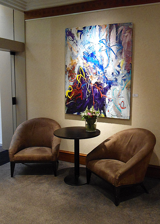 One painting above chairs