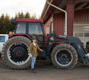 Standing next to a tractor
