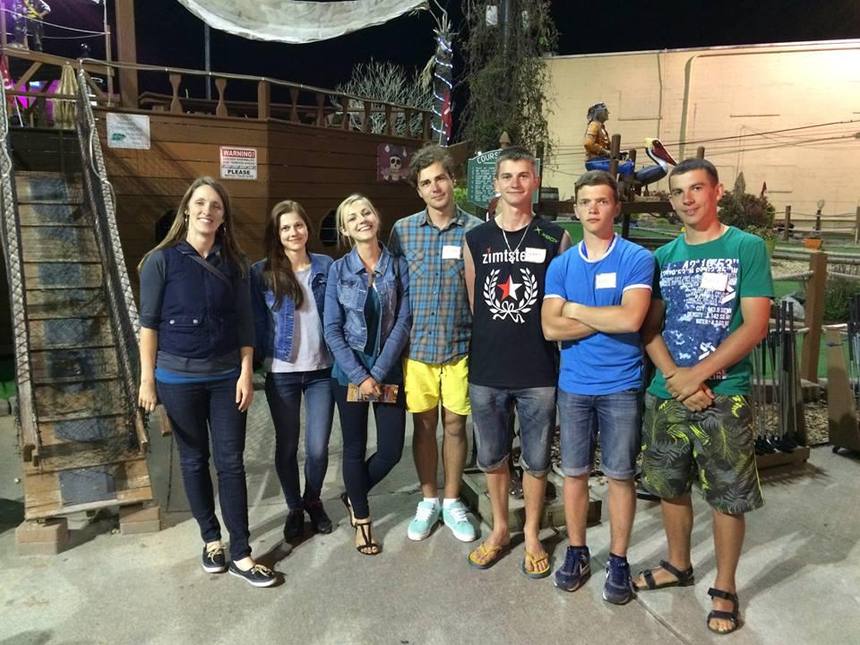 Ukrainian students in Virginia Beach took a night off to mini-golf with ERDT Work & Travel Program director Emily Reppun (at left).