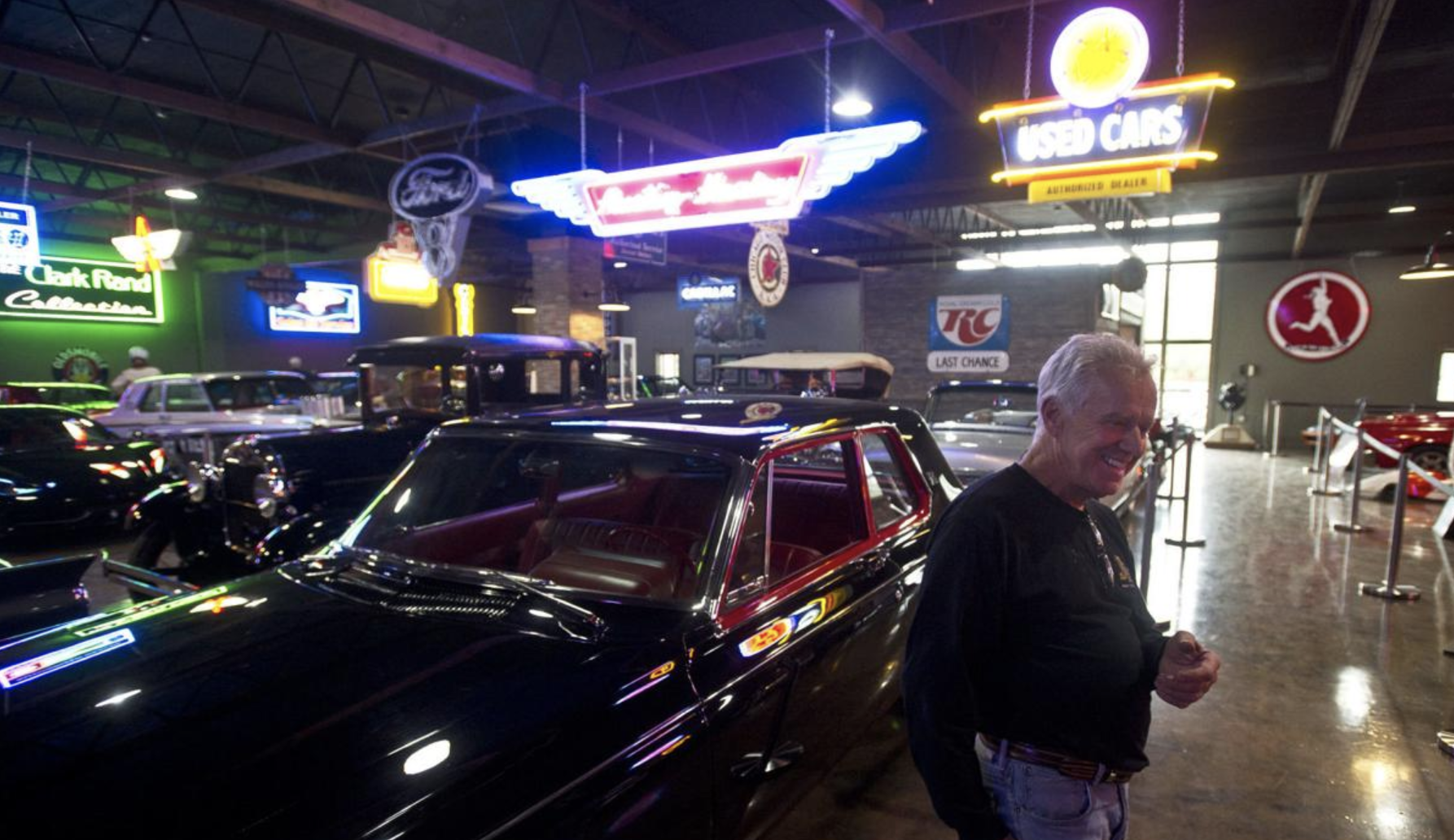Jim Remlinger talks about the cars that will be up for auction next weekend while standing next to his collection of cars at Remlinger's Muscle Cars— where the auction will be held.  Chuck Miller, Winona Daily News