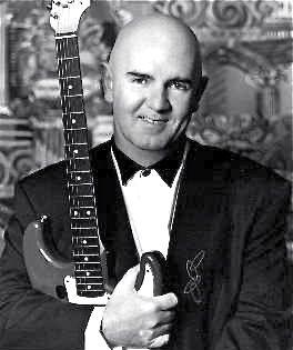 Denny-Leroux-with-guitar.jpeg