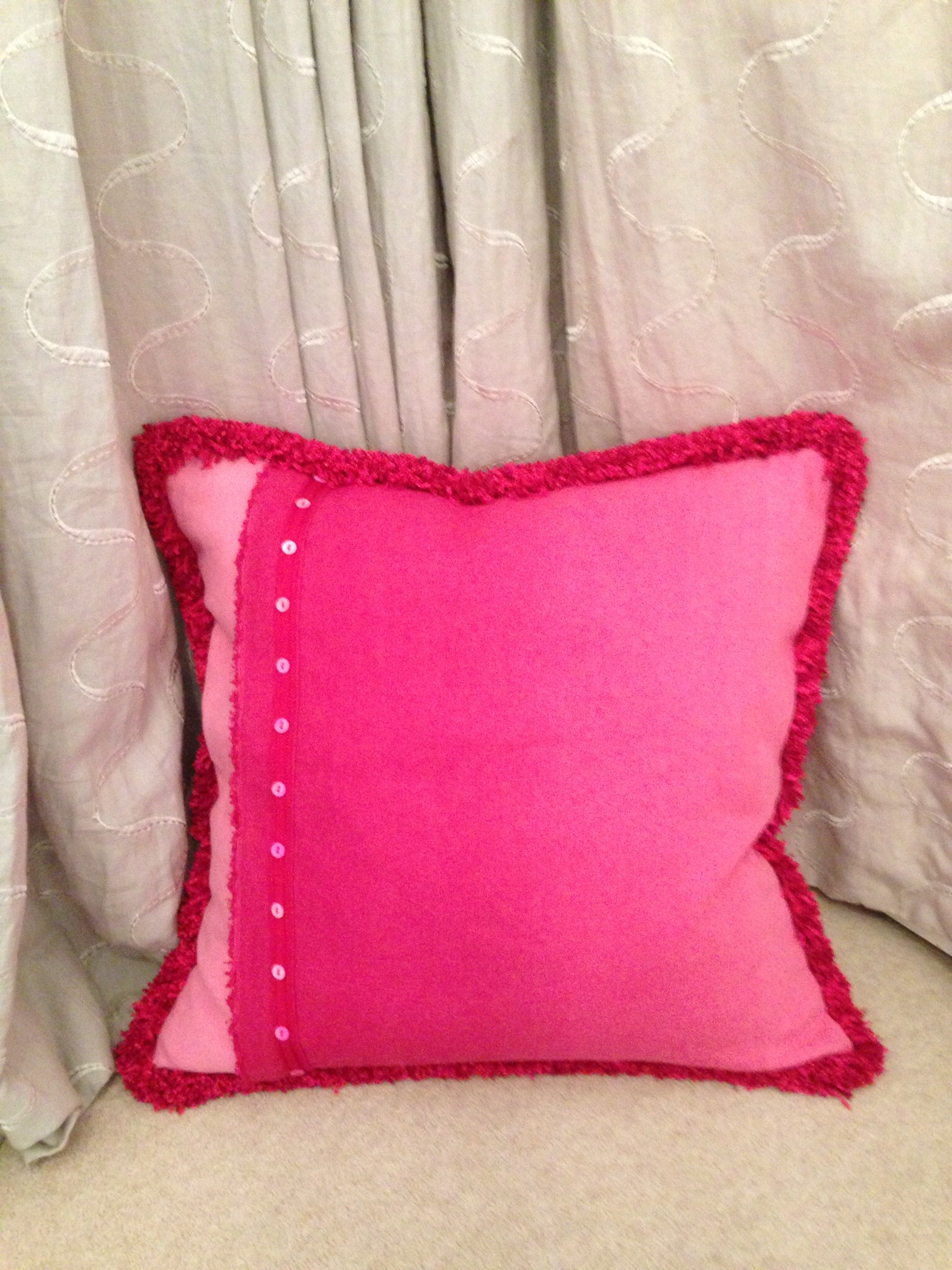 Beautiful pink ombré fabric from Designers Guild....made into a cushion with button and fuzzy trim detail from the #Opus collection @Hallis Hudson