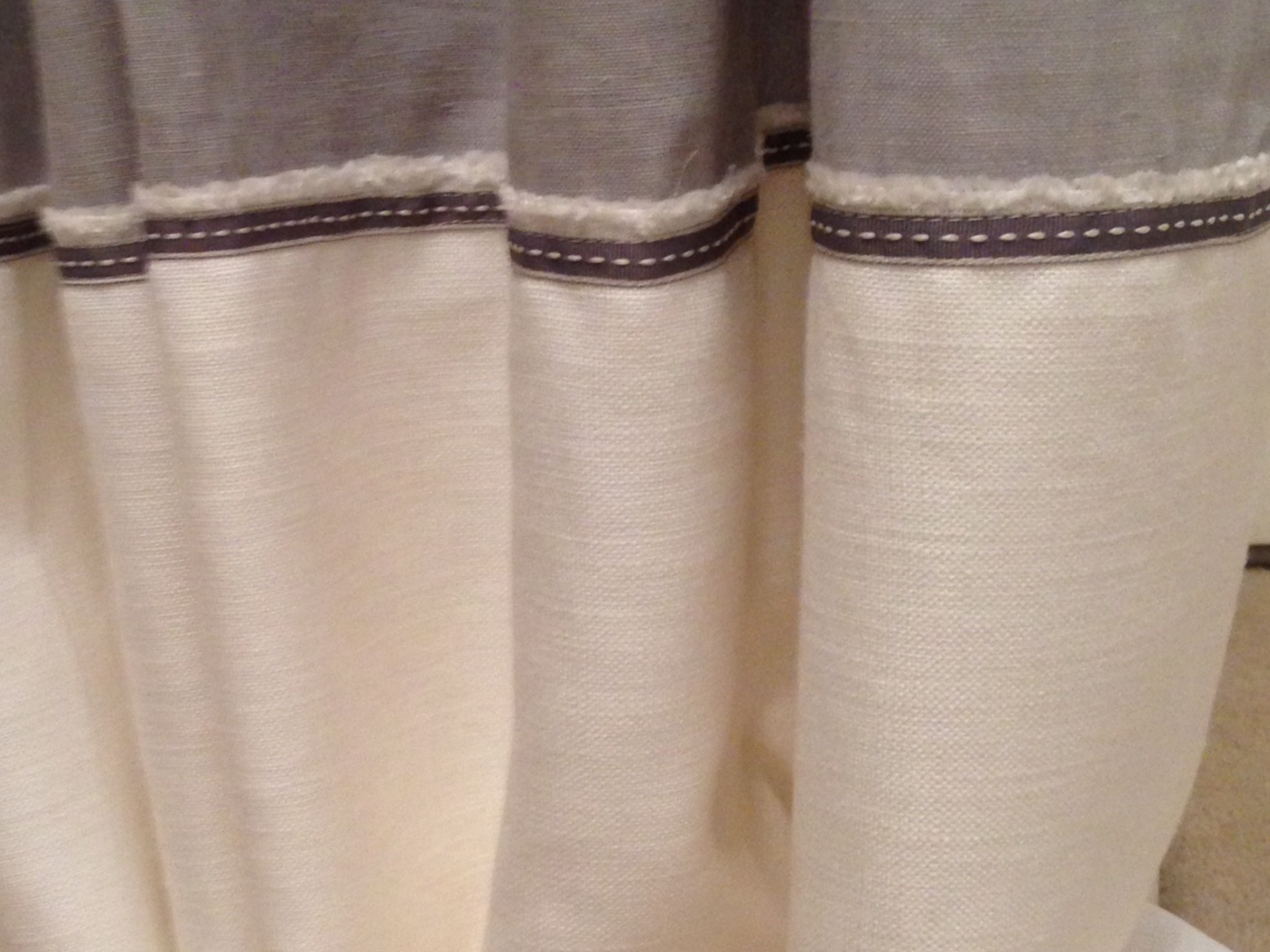 Braid detail on the bottom of the hall curtains. We loved the frayed detail of the selvage so we left it showing.