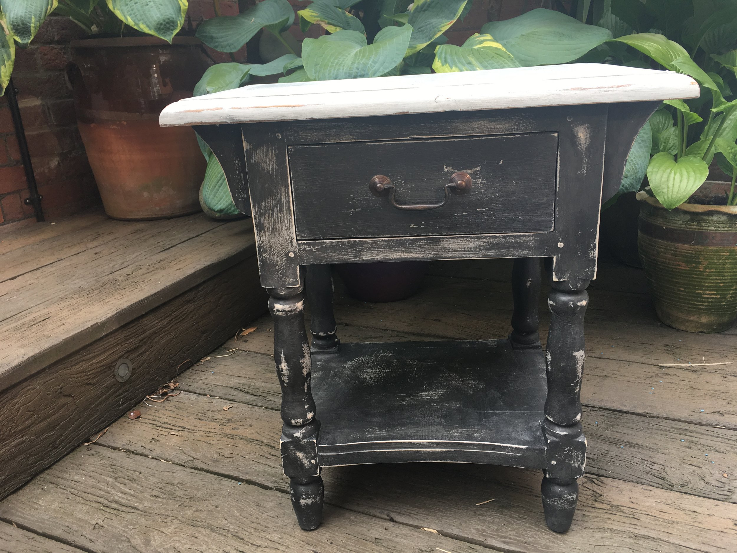 The units were painted in Annie Sloan Paris Grey with a final coat of Graphite, distressed back to show the Paris grey through. The tops are Paris grey.