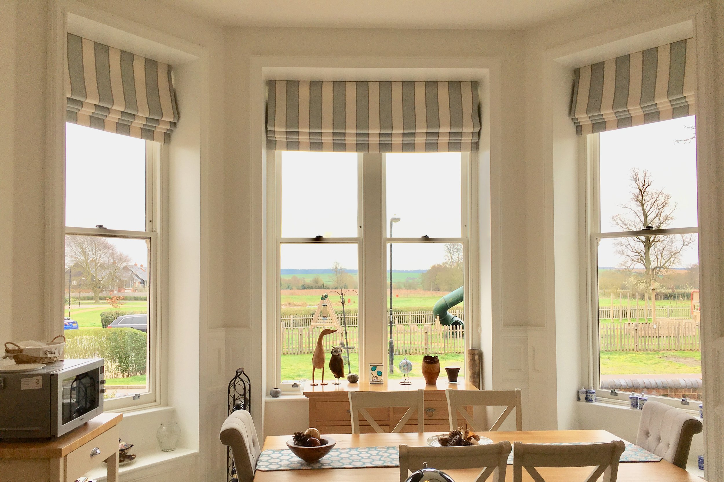 Roman Blinds set inside the recess keep this window looking fresh and uncluttered