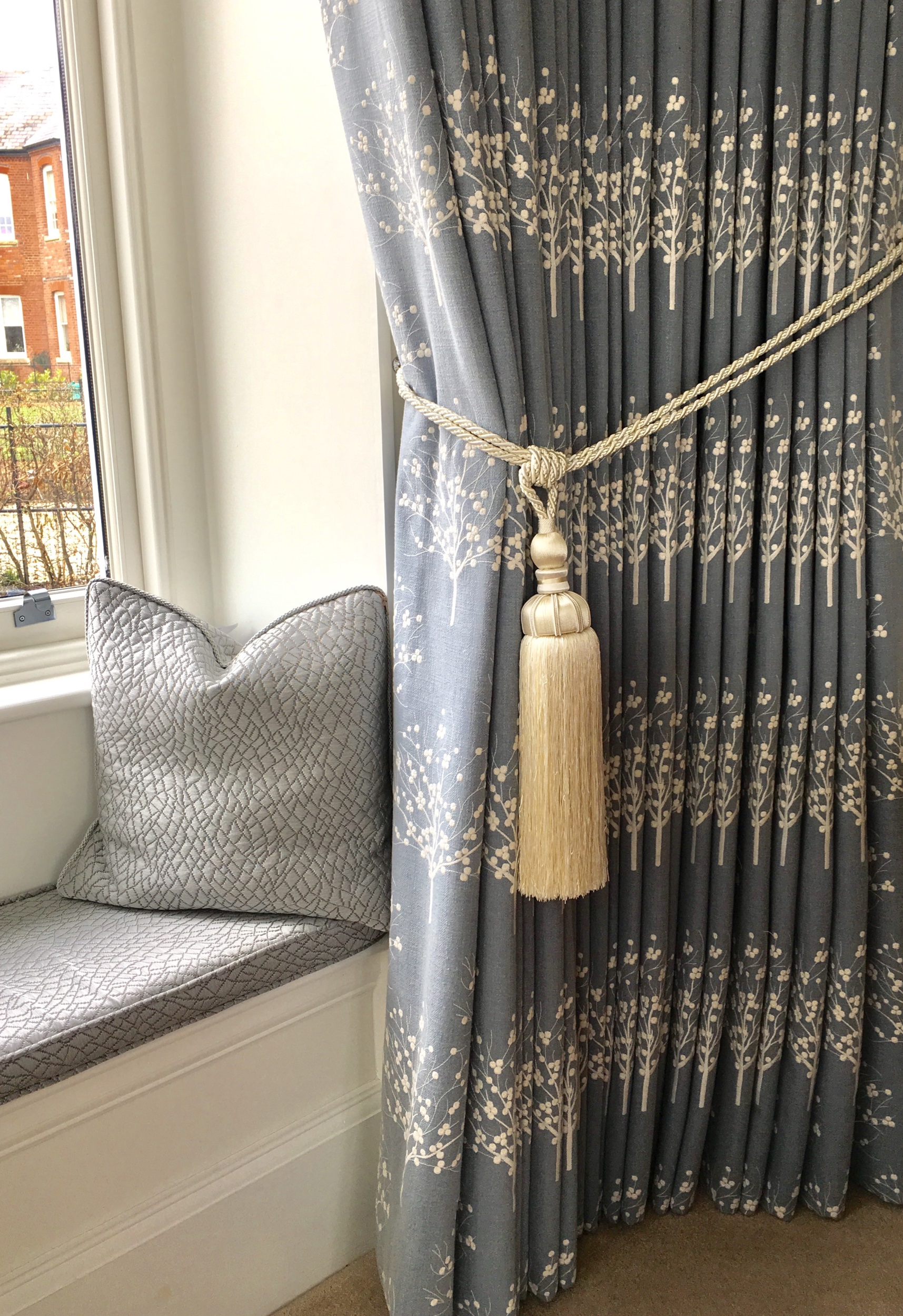 Beautifully pleated to pattern cartridge headed curtains. The fabric is Clarke & Clarke - Bowood Chambray rap £48pm  Cushion and seat pad fabric is Robert Allen - Opal Creek Silver rap £67pm  Tiebacks are Marrakesh - Aubergine