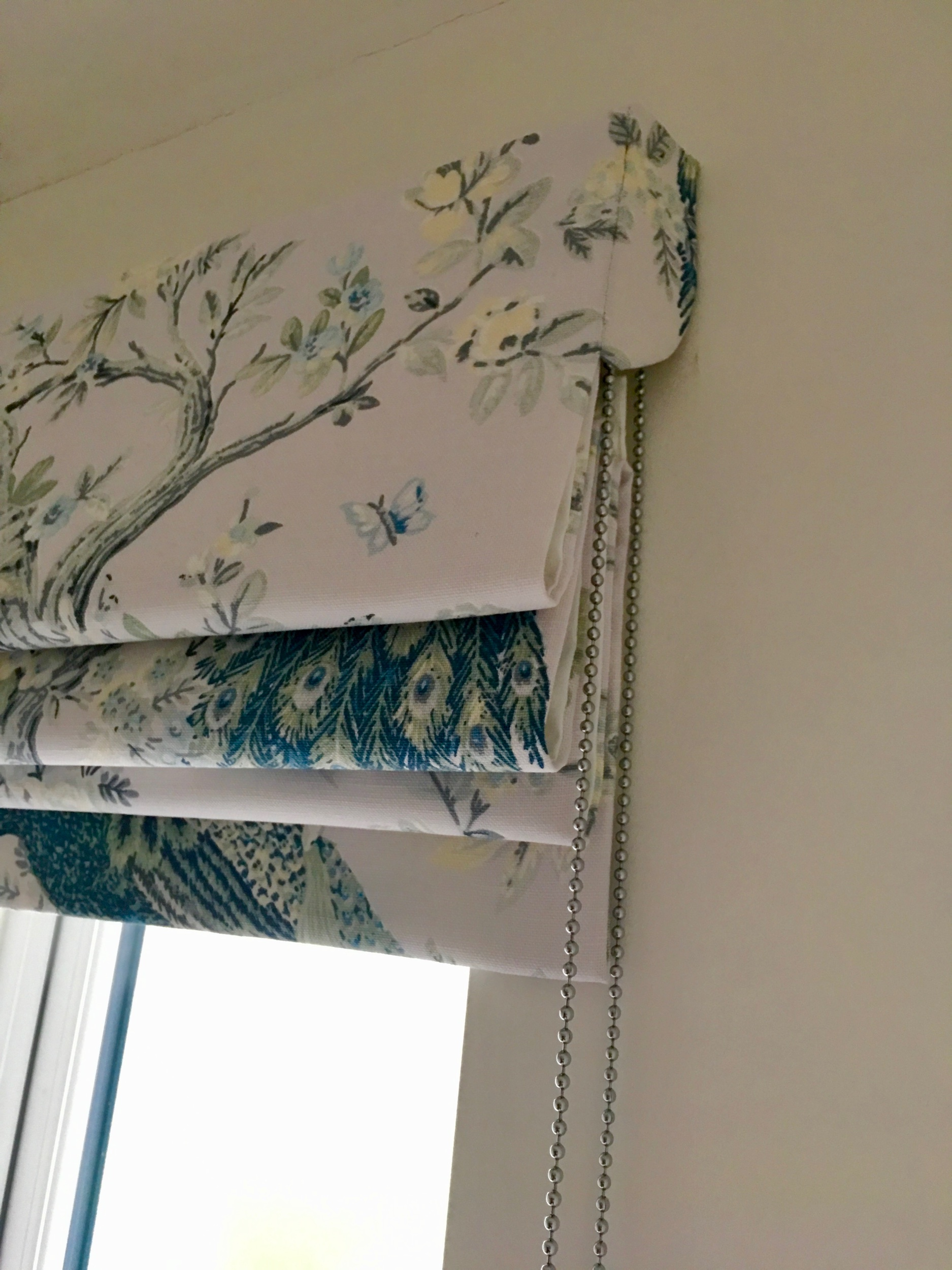 Carefully pattern matched side returns give a streamlined look to the Roman blind