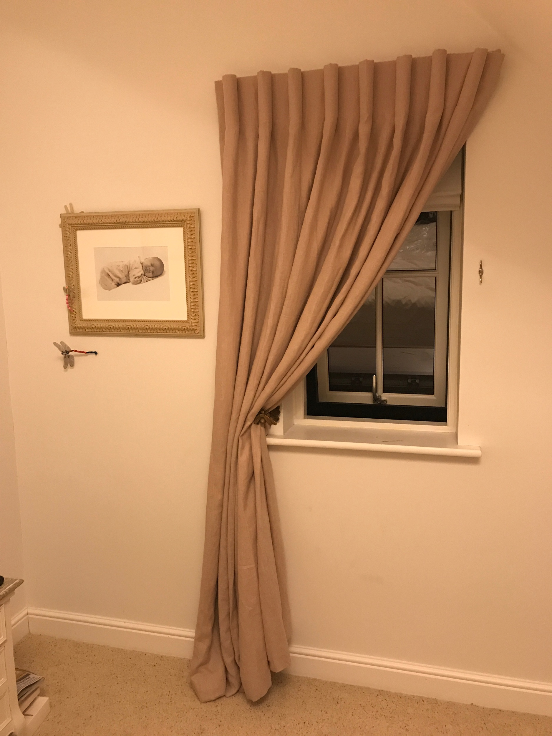 Single curtain swept to one side