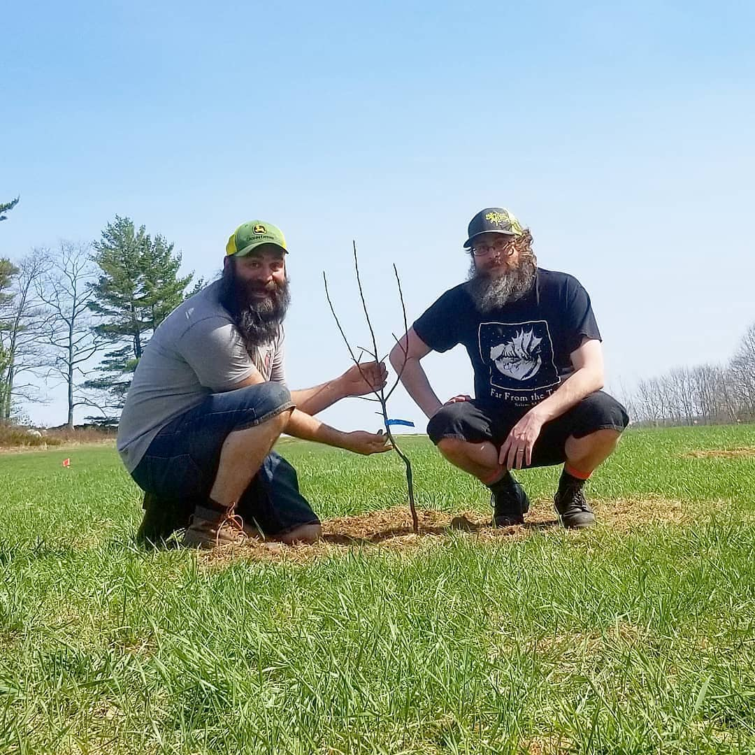 Al and Erik planting the first tree at Far From The Tree Orchard.