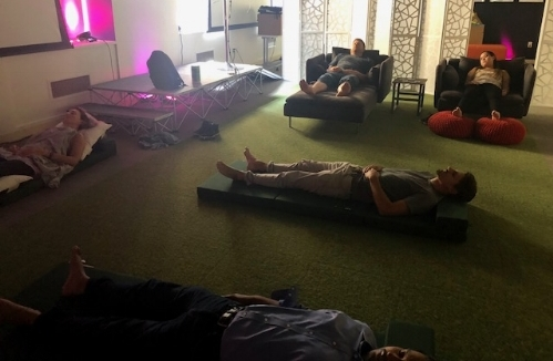Mesosphere employees in downtown SF enjoying the benefits of acupuncture during an onsite wellness event.