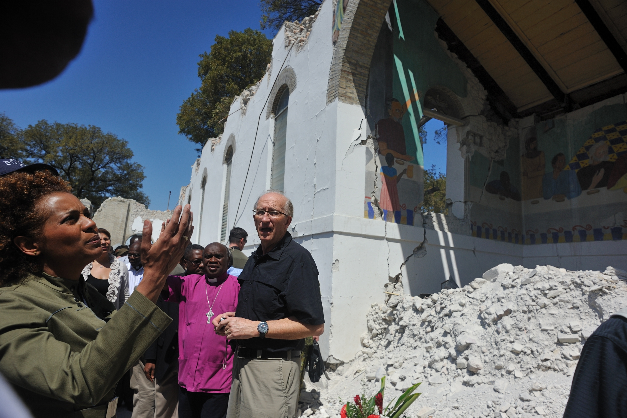 Their Excellencies visit locations in Port-au-Prince including the Cathédrale Épiscopale and the Sainte-Trinité school.