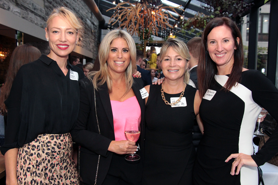 From left, Melissa Reeves, co-founder and COO of Linebox Studio, with fellow female mentors Jennifer McGahan, owner and principal designer of Jennifer McGahan Interiors, intellectual property and trademark lawyer Paula Clancy and Shannon Lambert, chief people officer at IT consulting firm Experis-Veritaaq, at the ELLE Gala hosted by The Entrepreneurs' Club at the University of Ottawa's Telfer School of Management. Photo by Caroline Phillips