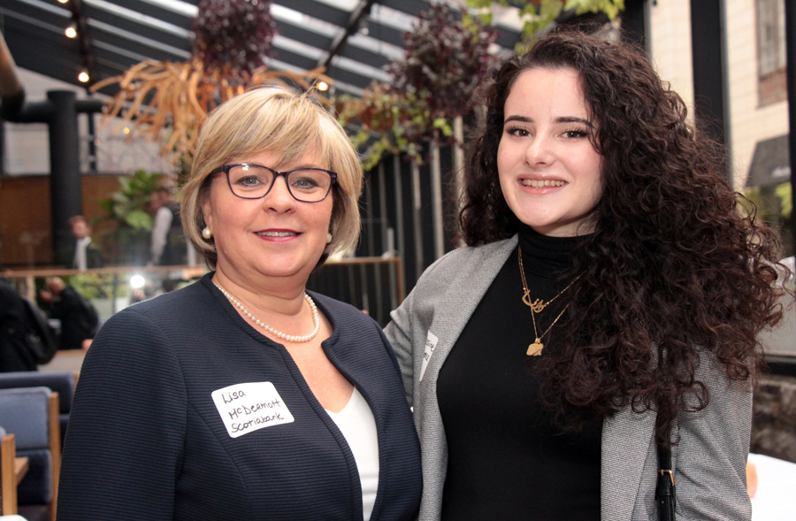 Female mentor Lisa McDermott, director and group lead of commercial banking at Scotiabank, with second-year finance student Danna Yassine at the ELLE Gala organized by The Entrepreneurs' Club at the University of Ottawa's Telfer School of Management program. Photo by Caroline Phillips