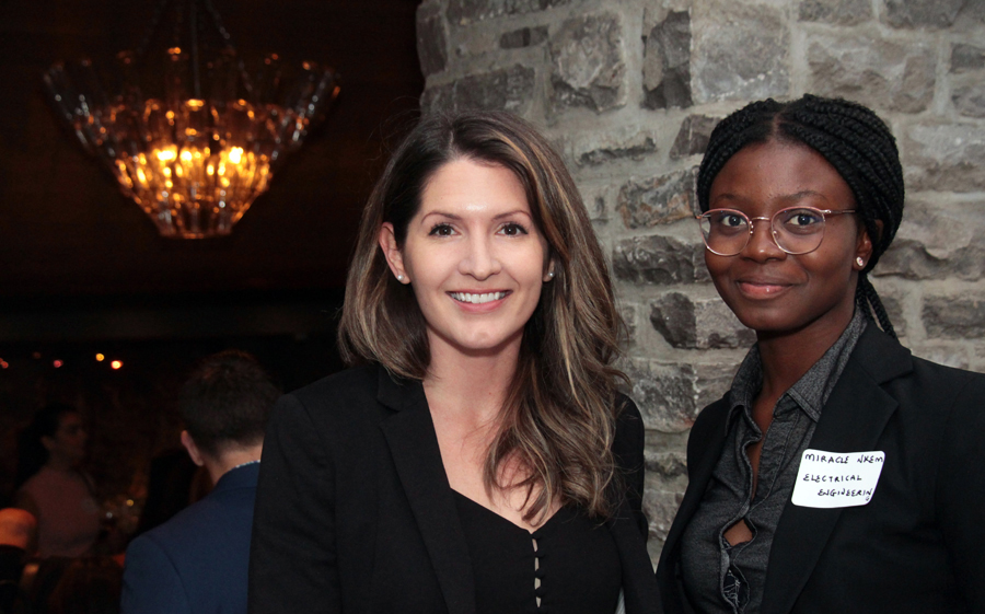 From left, Gillian Fischer, manager of adoption and advocacy at MindBridge Ai, with electrical engineering student Miracle Nkemdirim at the ELLE Gala organized by The Entrepreneurs' Club at the University of Ottawa's Telfer School of Management. Photo by Caroline Phillips