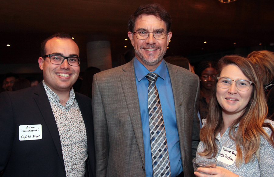 Telfer School of Management dean François Julien, centre, at the ELLE Gala with alumni Adam Tomaszewski, vice-president of sales at Capital Meat, and Kathleen Kemp, manager of uOttawa's eHub. Photo by Caroline Phillips