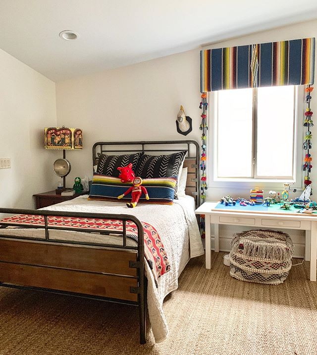 We loved using an incredible vintage serape for the cornice and bed pillow in this colorful boys room! #beccastephensinteriors #interiordesign #austintx #austindesigner #boysroom #kidsroom #vintagedesign #globalinspired #ihavethisthingwithtextiles