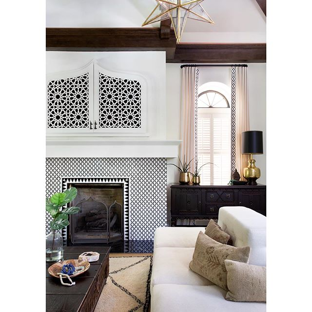 Here's another pic of the fireplace, which is one of my very favorite elements in the house. 🖤  Tiles by @tilesofezra, installed by @thetilepress. TV cabinet made by @michelleoliviaa. Drapery by @plushhomefabric. It took a village (as always). 💕 Pic by @mollyculverphotography  #beccastephensinteriors #interiordesign #austintx #homedesign #globallyinspiredinteriors #globallyinspireddecor #interiordecorating #moroccanmodernbsi #moroccandesign #moorishdesign #historichomes #hydeparkaustin #austininteriordesign