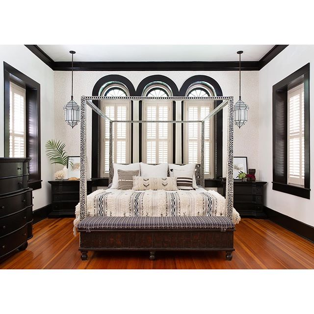 We're back this week and heading to the master bedroom on the tour of our #moroccanmodernbsi project. We painted the trim black for some depth and drama, which worked perfectly with the inlaid canopy bed. Swipe 👉 to zoom in on the back wall that's stenciled with a subdued pattern that gives one more layer to the room and also pulls in the darker cream color on the shutters (which we didn't want to repaint!). We also tackled the fireplace in this room, which is opposite the bed. Photos by @mollyculverphotography  #beccastephensinteriors #interiordesign #austininteriordesign #austintx #homedesign #historichome #moroccandesign #moorishdesign #hydeparkaustin