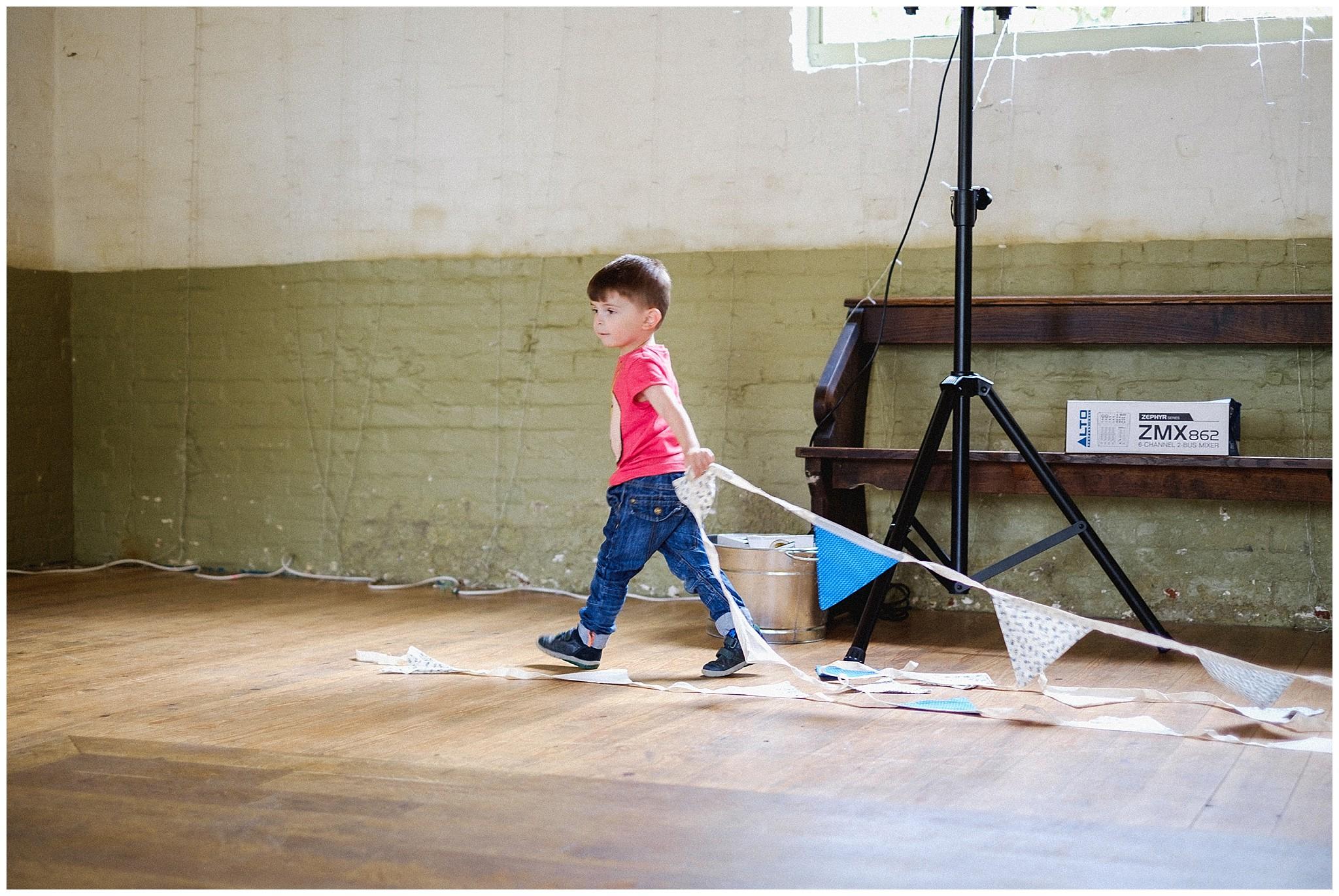 Little boy helps decorate the wedding