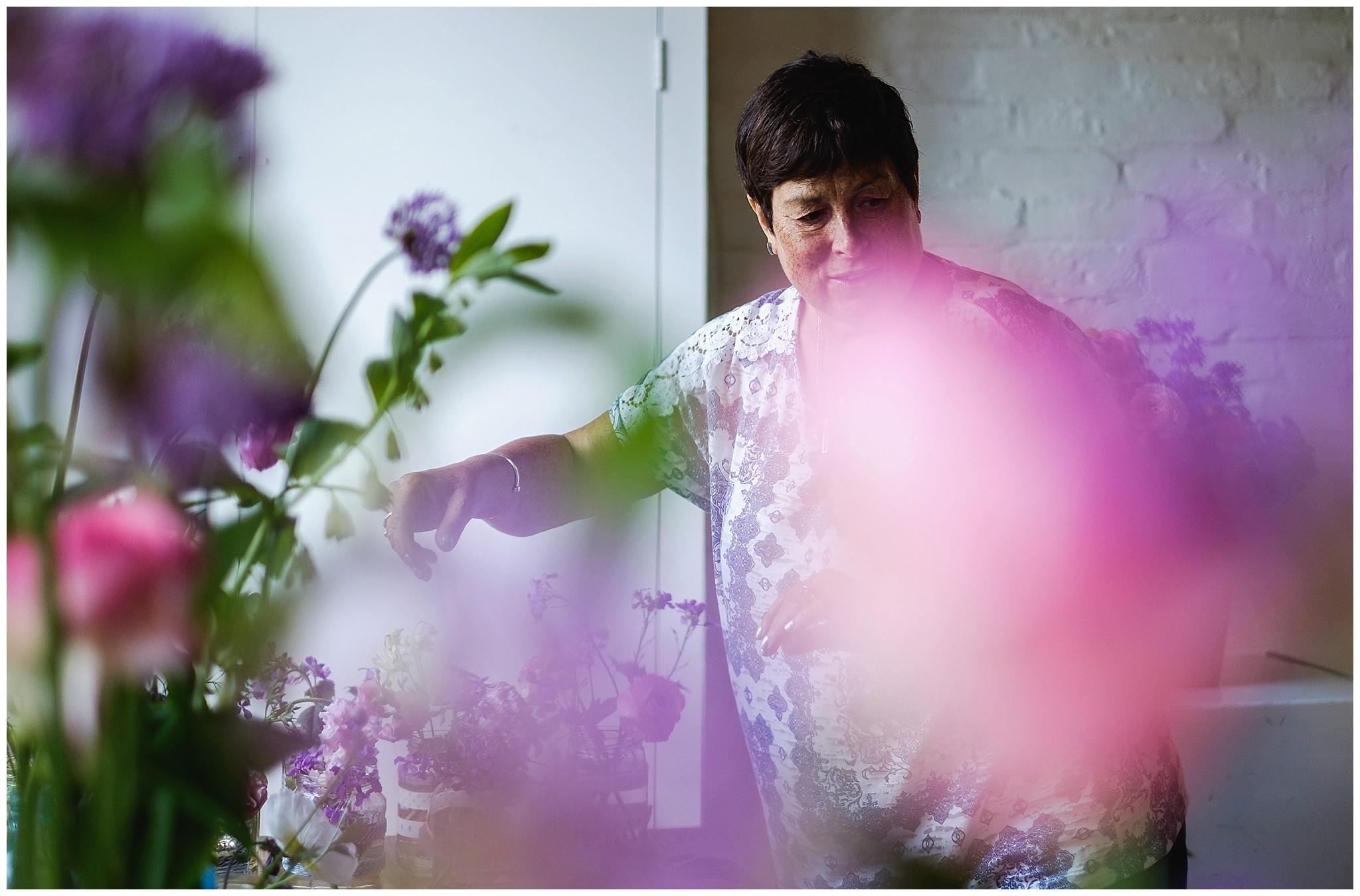 mum prepares wedding flowers