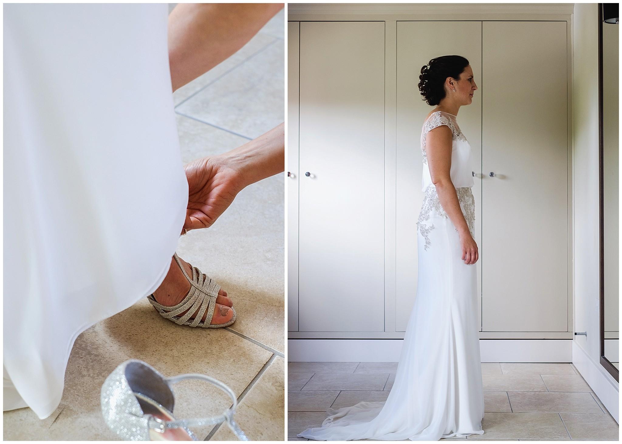 bride looks in the mirror