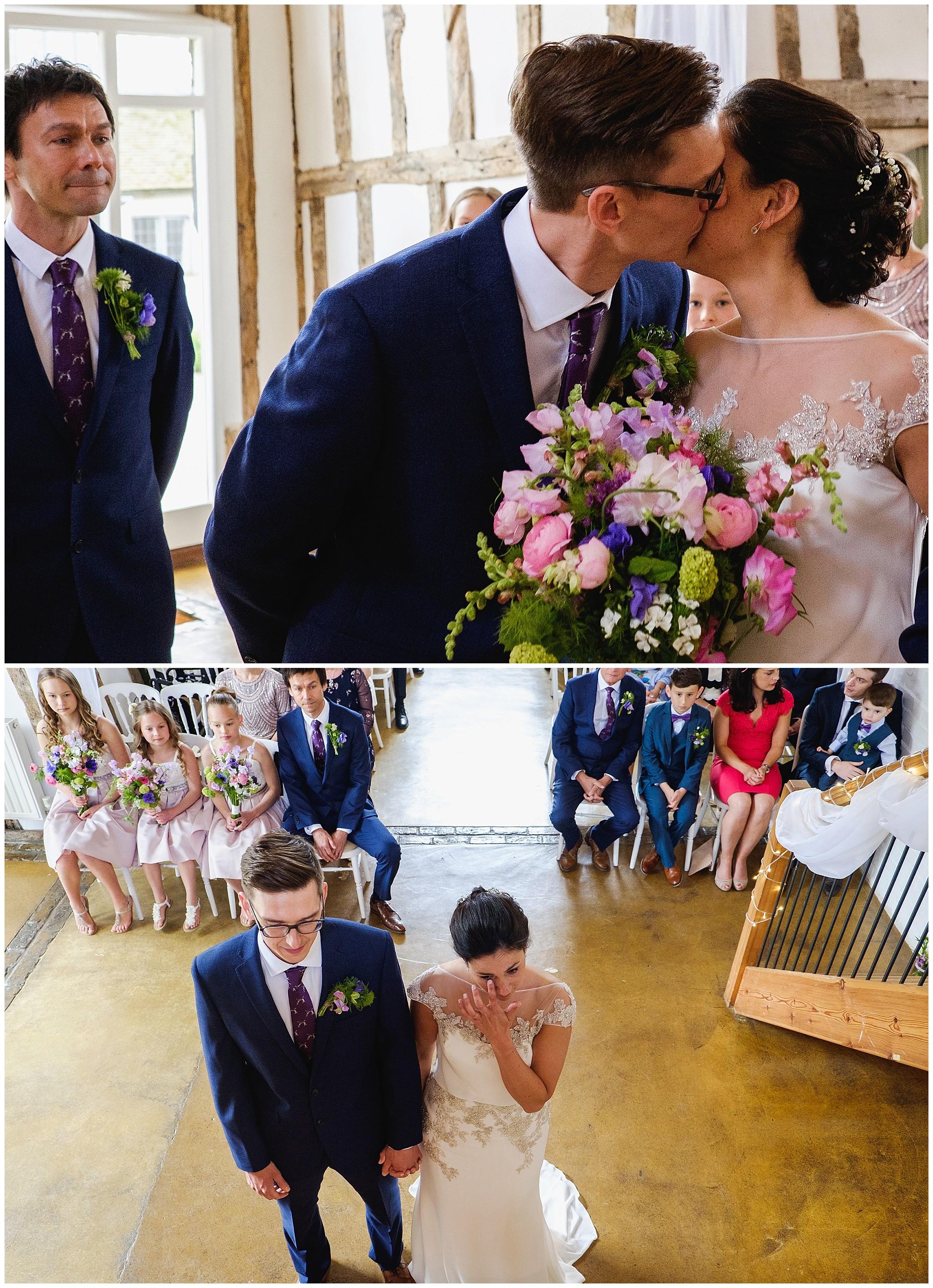 Groom kisses bride as Best man wears