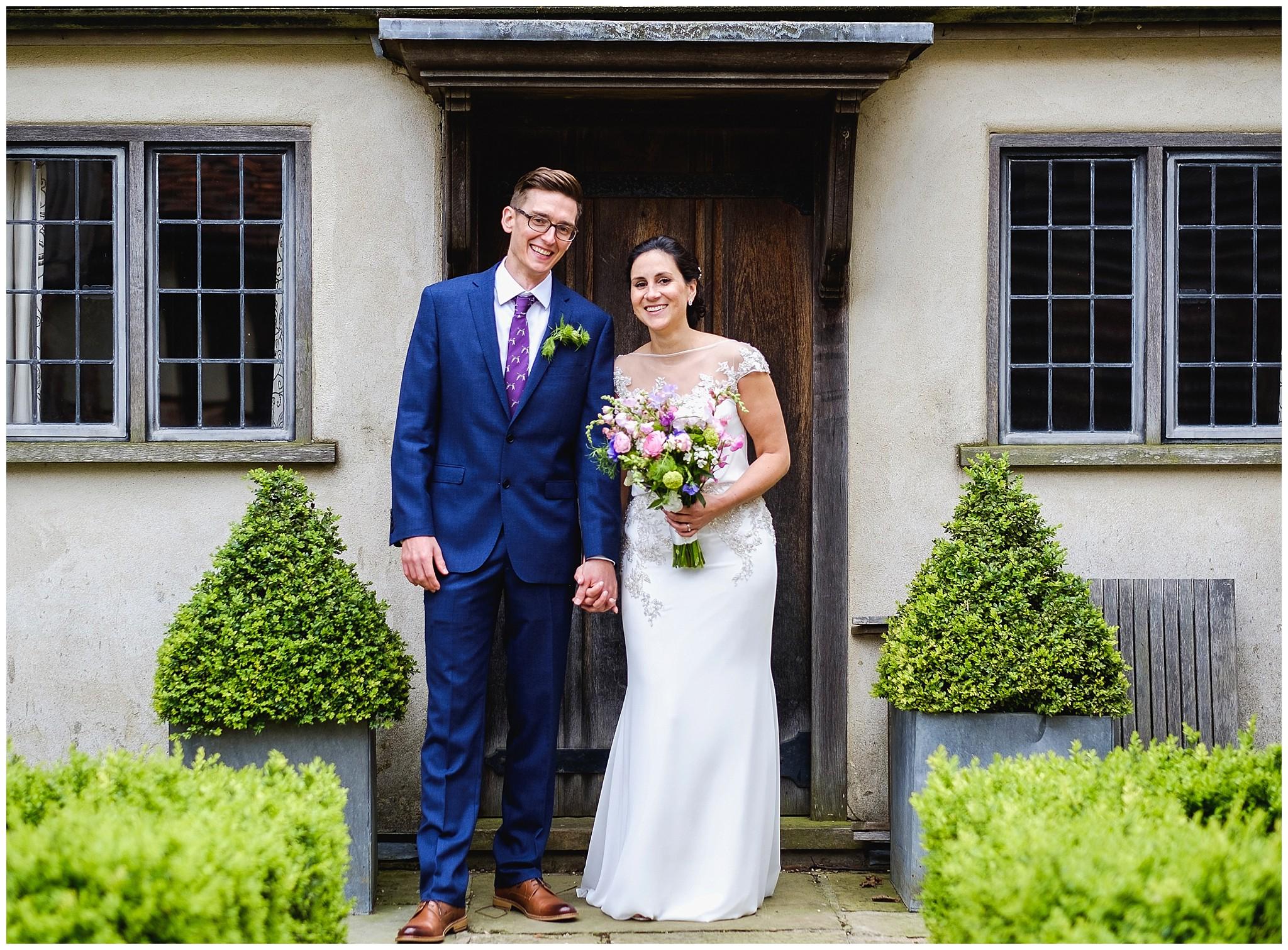 Wedding couple portrait outside old door