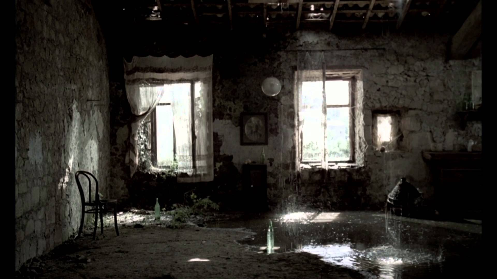 "Still from Tarkovsky's  Nostalghia , 1983. ""Separation of light from darkness, of the dry land from the waters""."