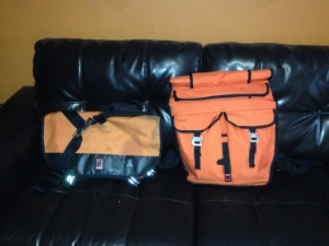 Messenger Bag on the left. Cyclist specific backpack on the right.Both bags are produced by Chrome Ind.