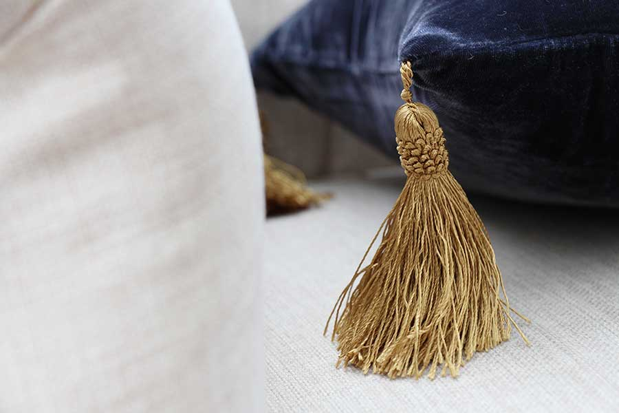 gold-and-black-pillow-detail-tassels.jpg