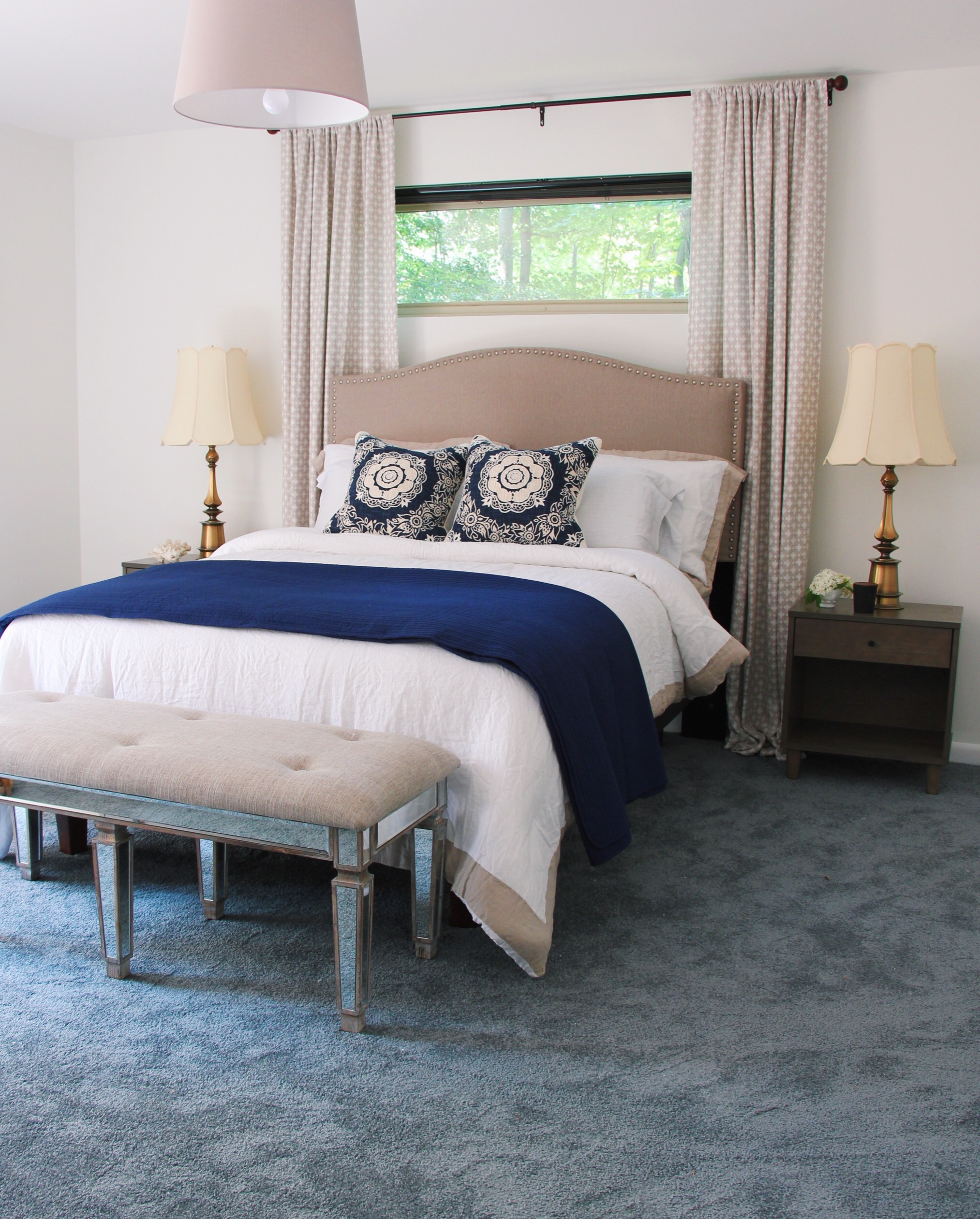 The master bedroom in a mix of blues and neutrals. Designed to rest and recharge.