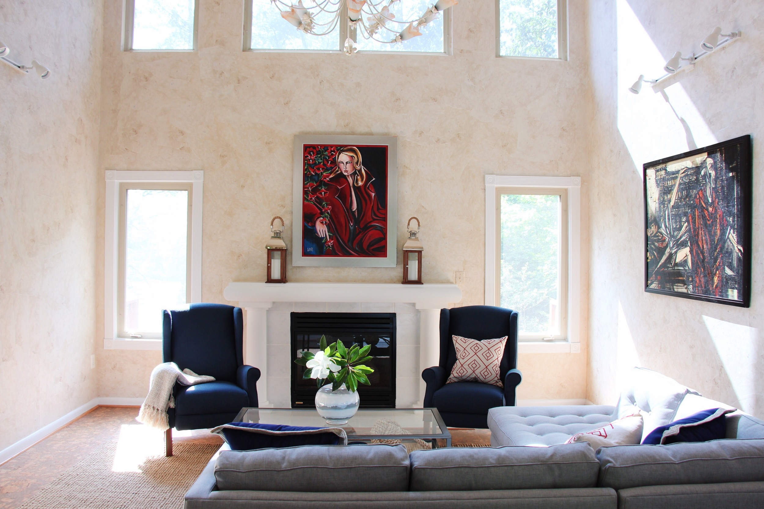 The pair of blue chairs are reclinable and perfect to read or take a nap next to the fireplace