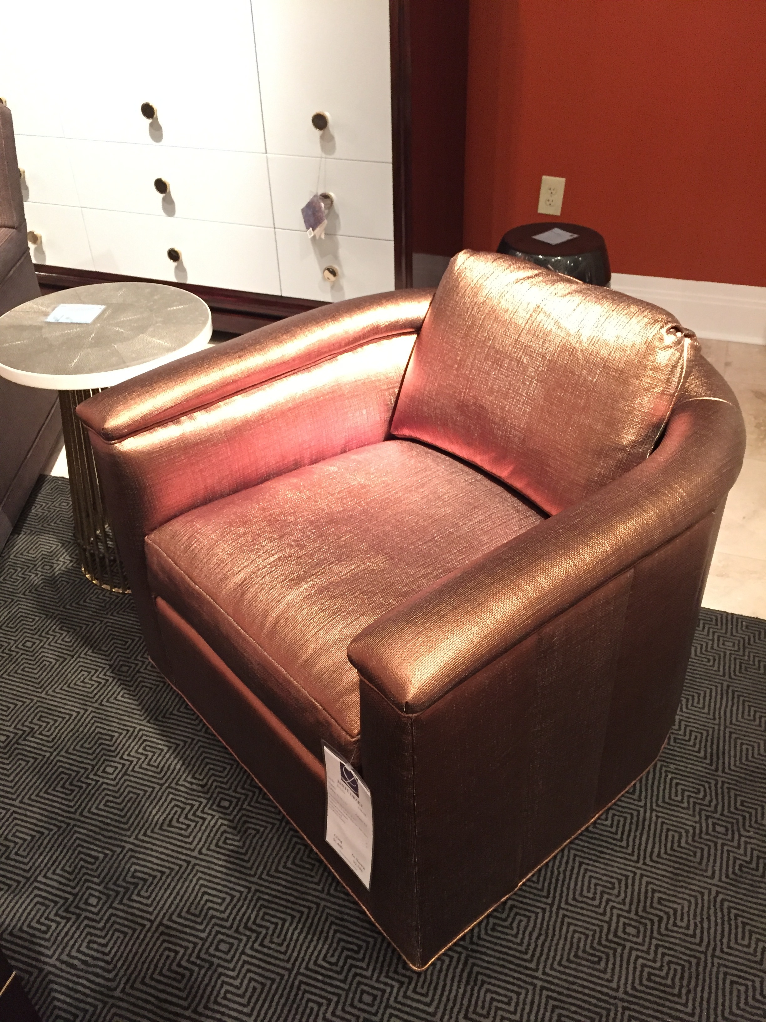 And a modern copper leather arm chair from  Theodore Alexander