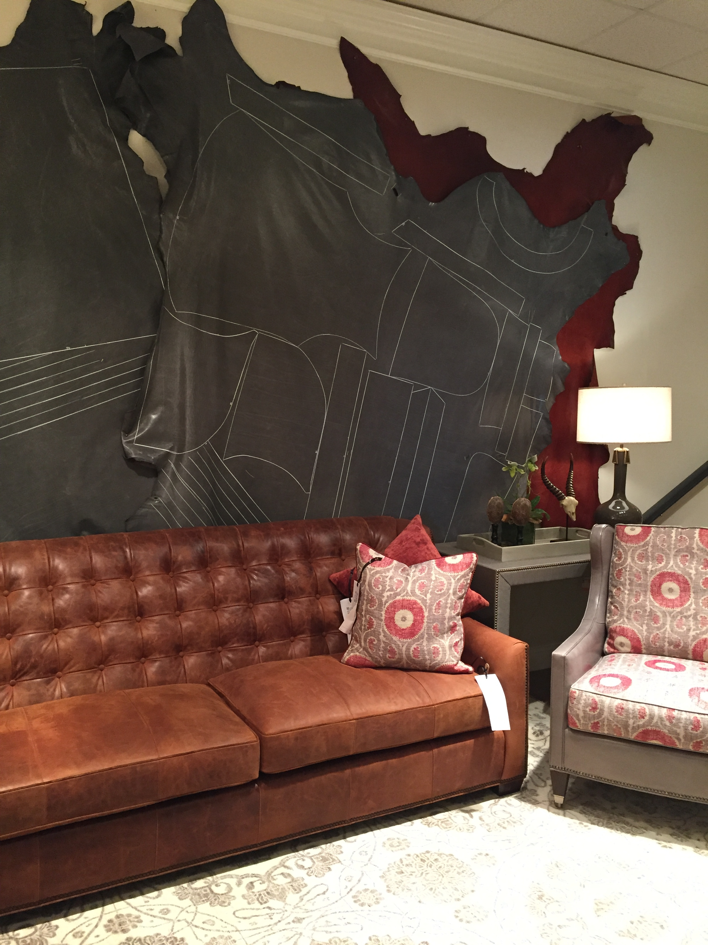 Wesley Hall  and their luxurious leathers! The drawings on the wall will soon upholster an arm chair. Ain't that amazing?