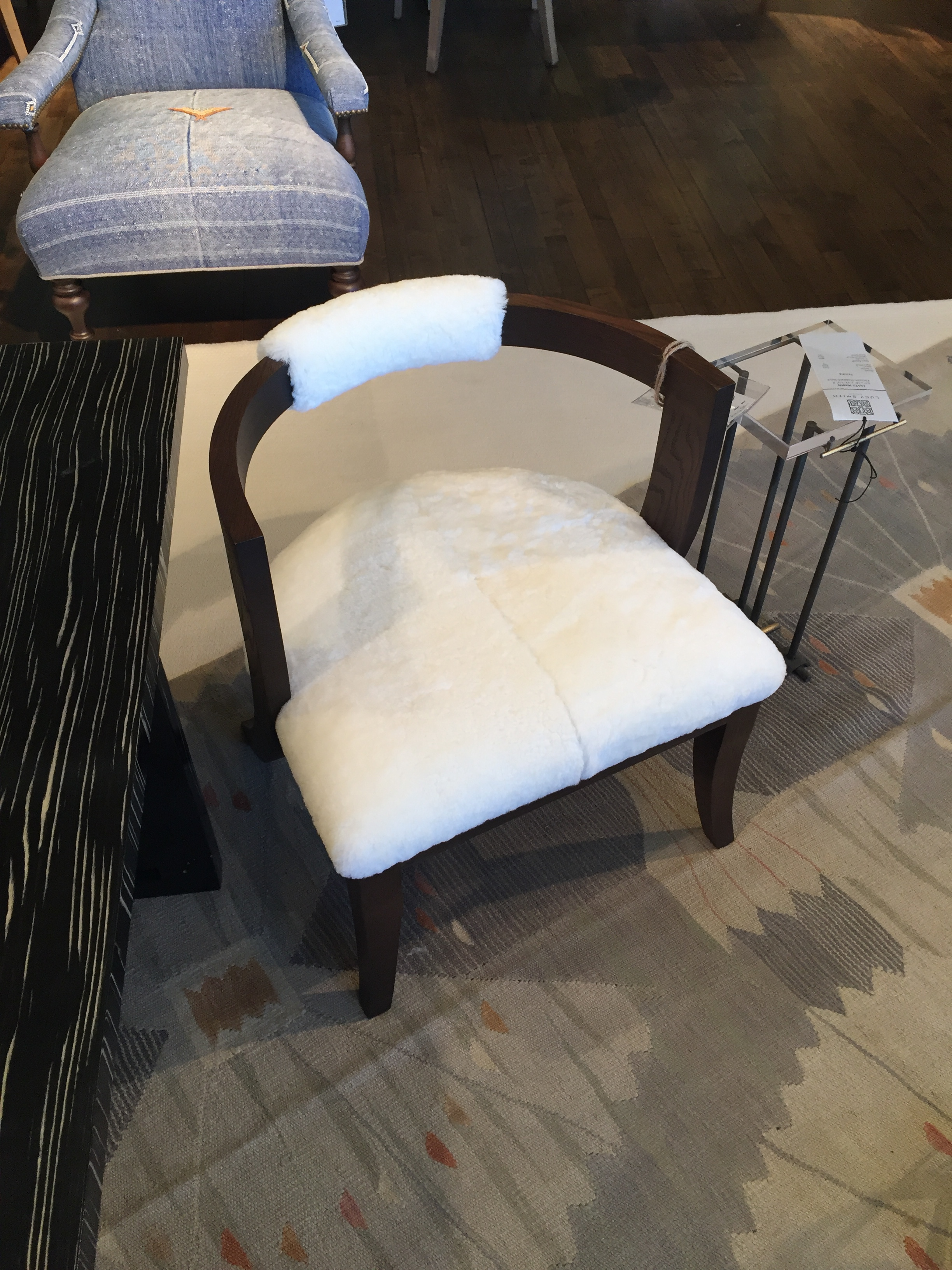 SHEEP SKIN on a curved-back chair in dark wood. Such a classic look by  Lee Industries . I would love to use it on both ends of a rectangular dining table.