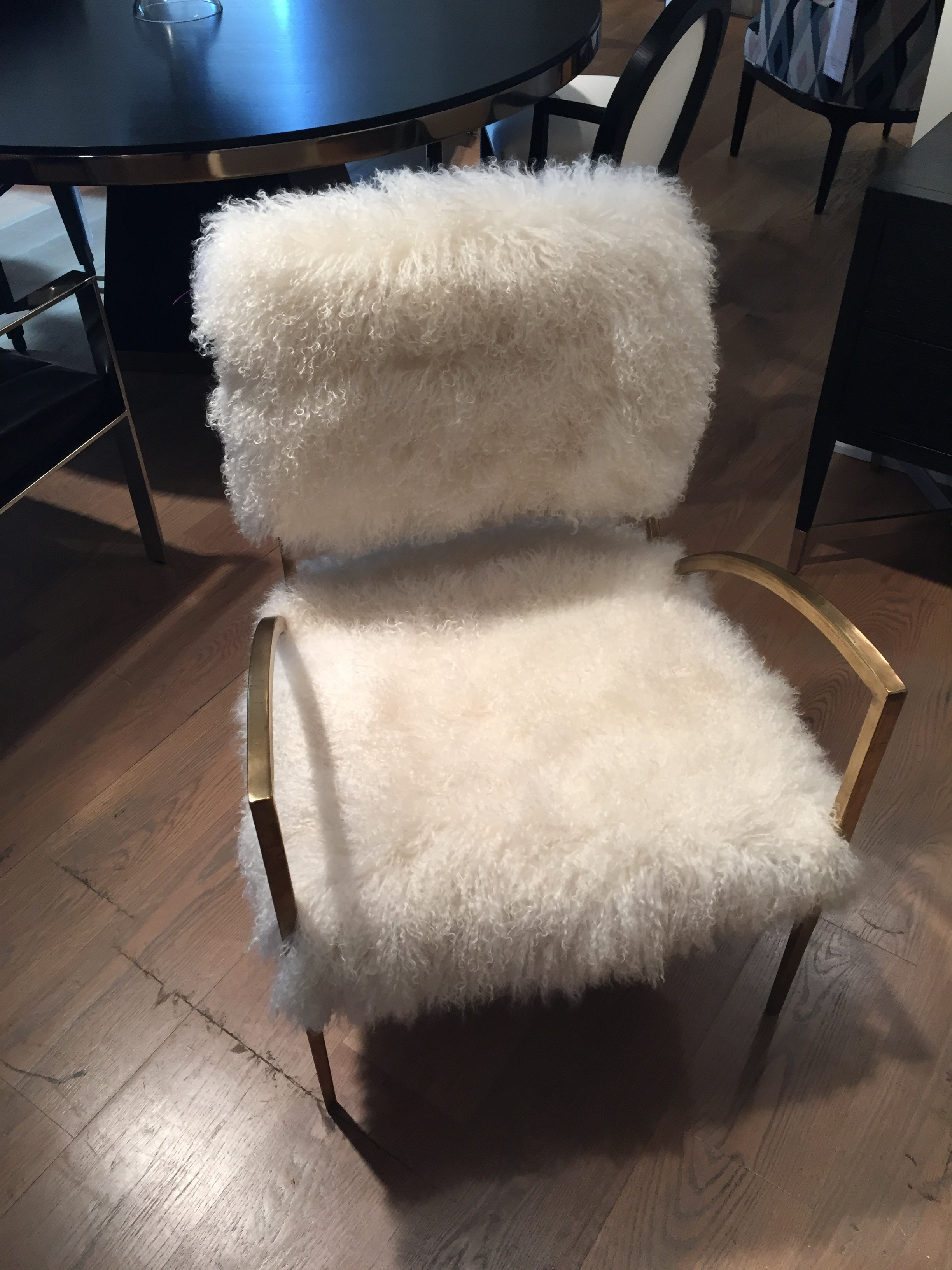 Faux fur and gold brass by  Lee Industries . I would love to see this piece adorning a walk-in closet's corner.