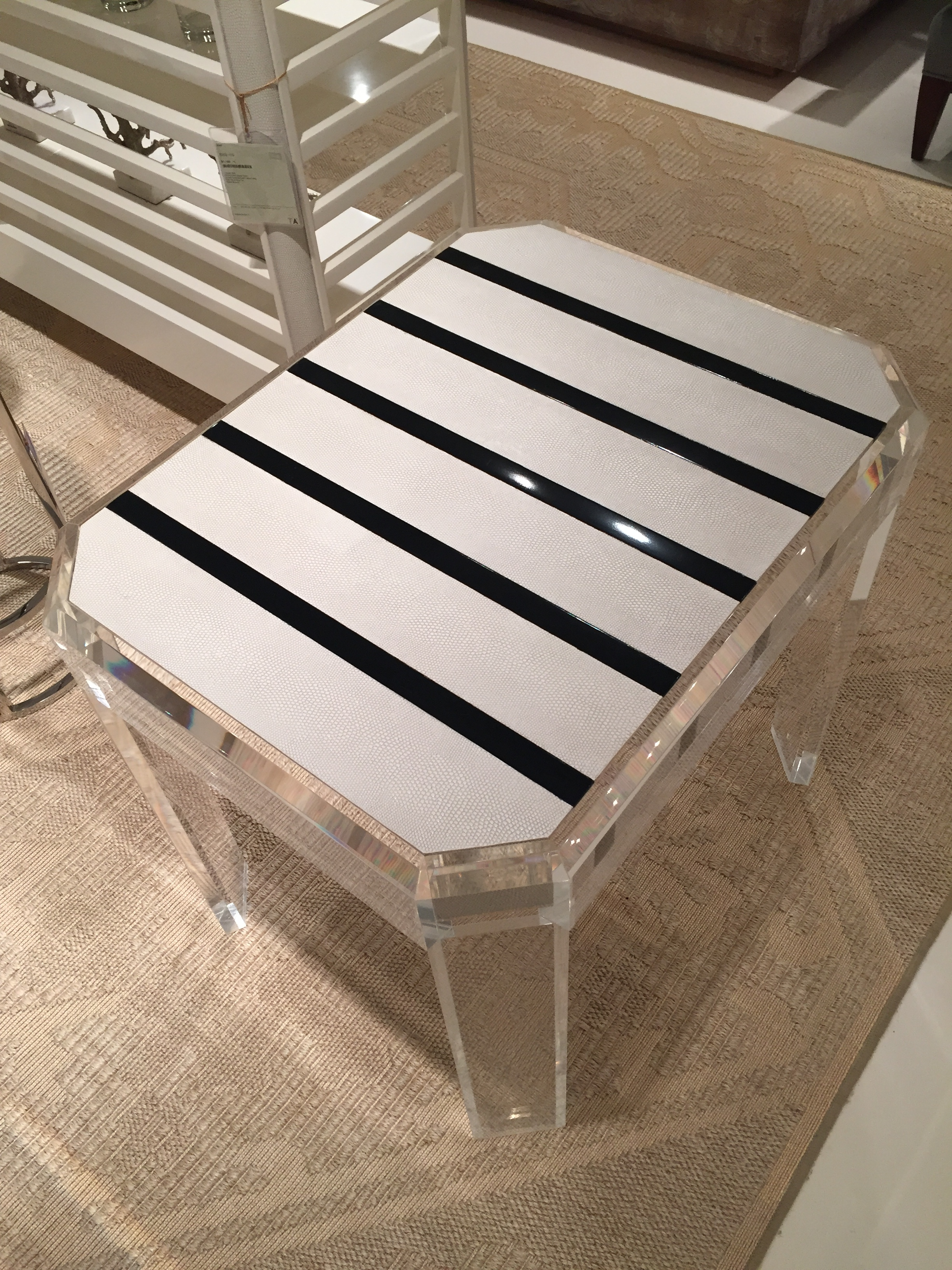 KOMODO DRAGON top on this lucite accent table by  Theodore Alexander . Create an immediate statement placing it in the middle of the room!
