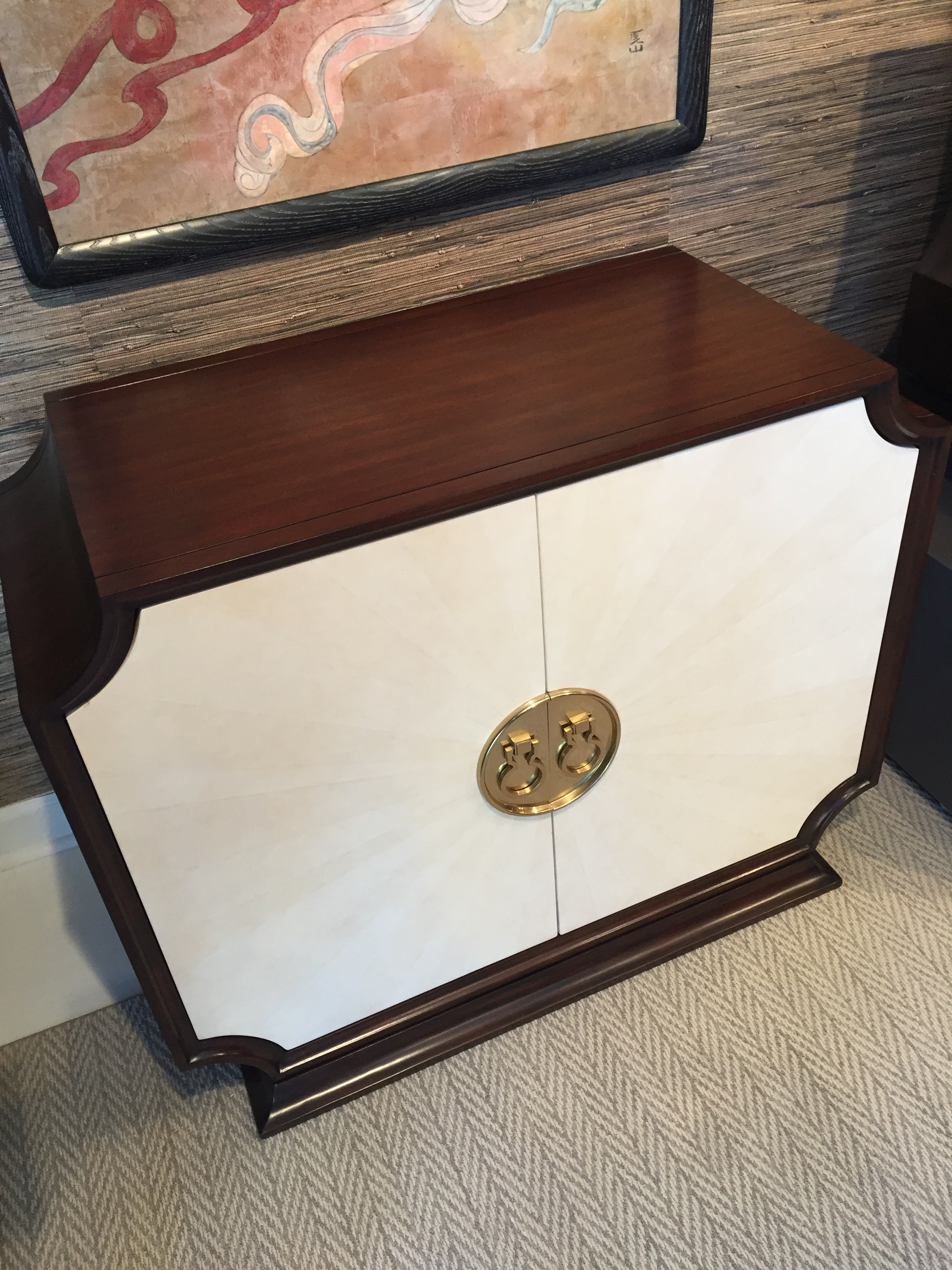 Radial white front on this cabinet by  Ambella Home . Love the shape and details on this piece. It will make an amazing bar cabinet!
