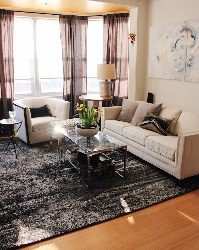 small-living-room-swivel-chair-white-sofa-chic-posh-modern-interiors-condo-washington-dc
