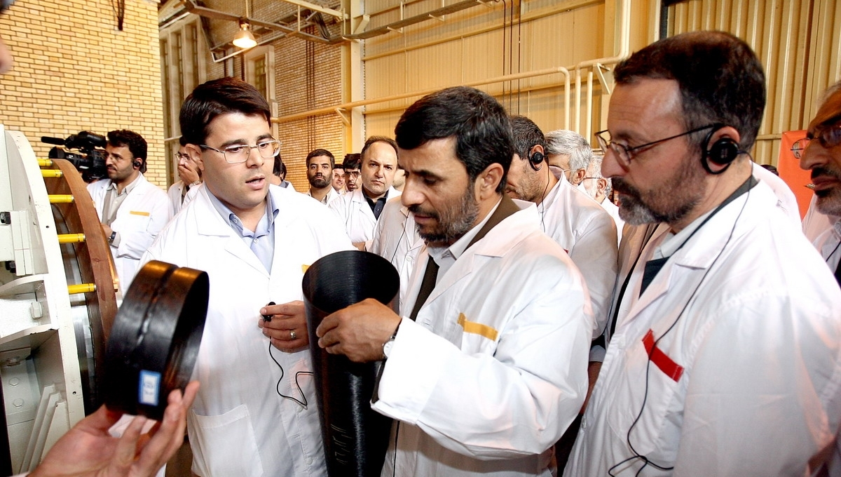 Iran's former president, Mahmoud Ahmadinejad inspects a carbon-fiber centrifuge rotor made possible by increasing globalization of previously sophisticated technologies. Photo: president.ir