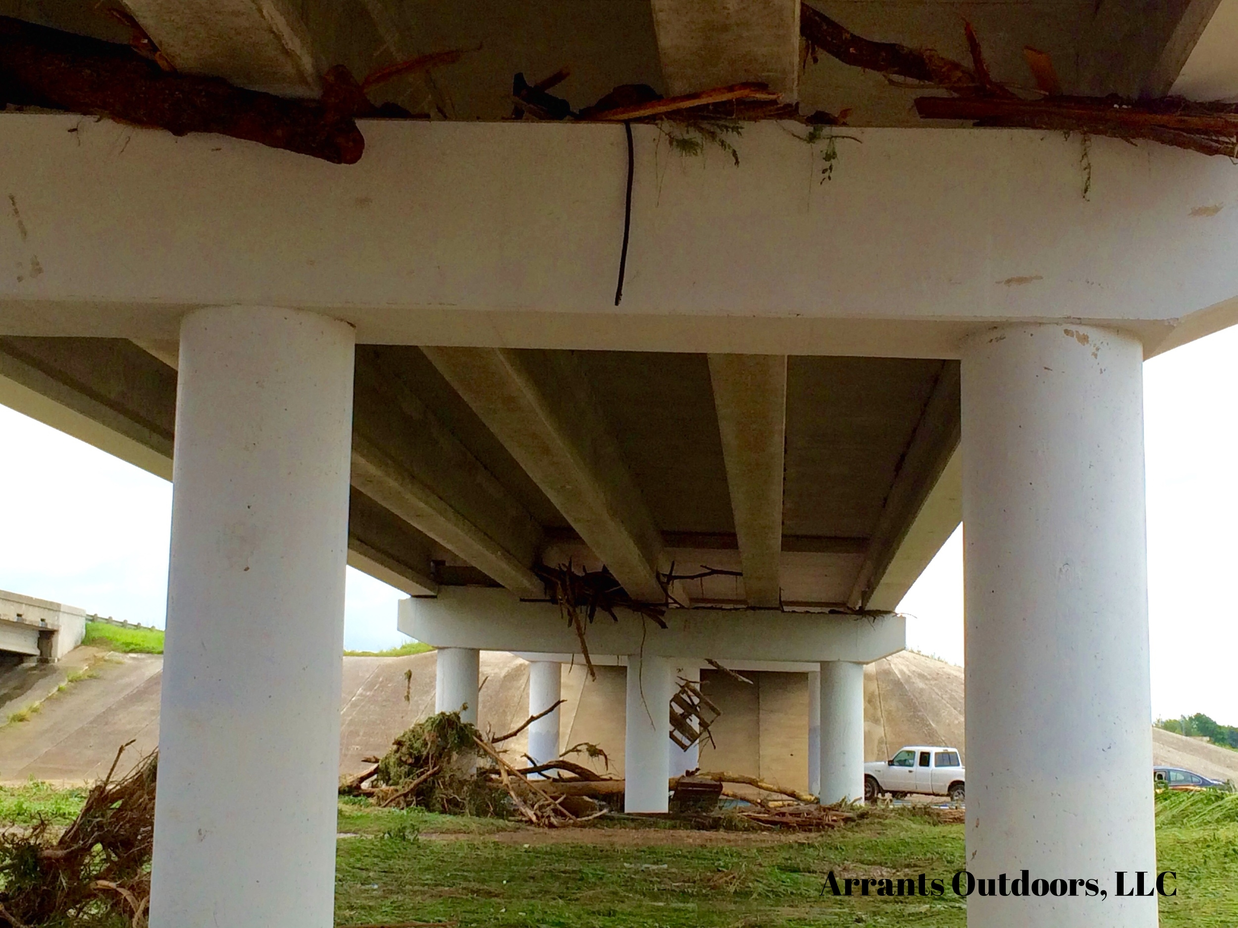 Debris under the bridge, even lodged underneath the bottom.  (Click to enlarge)
