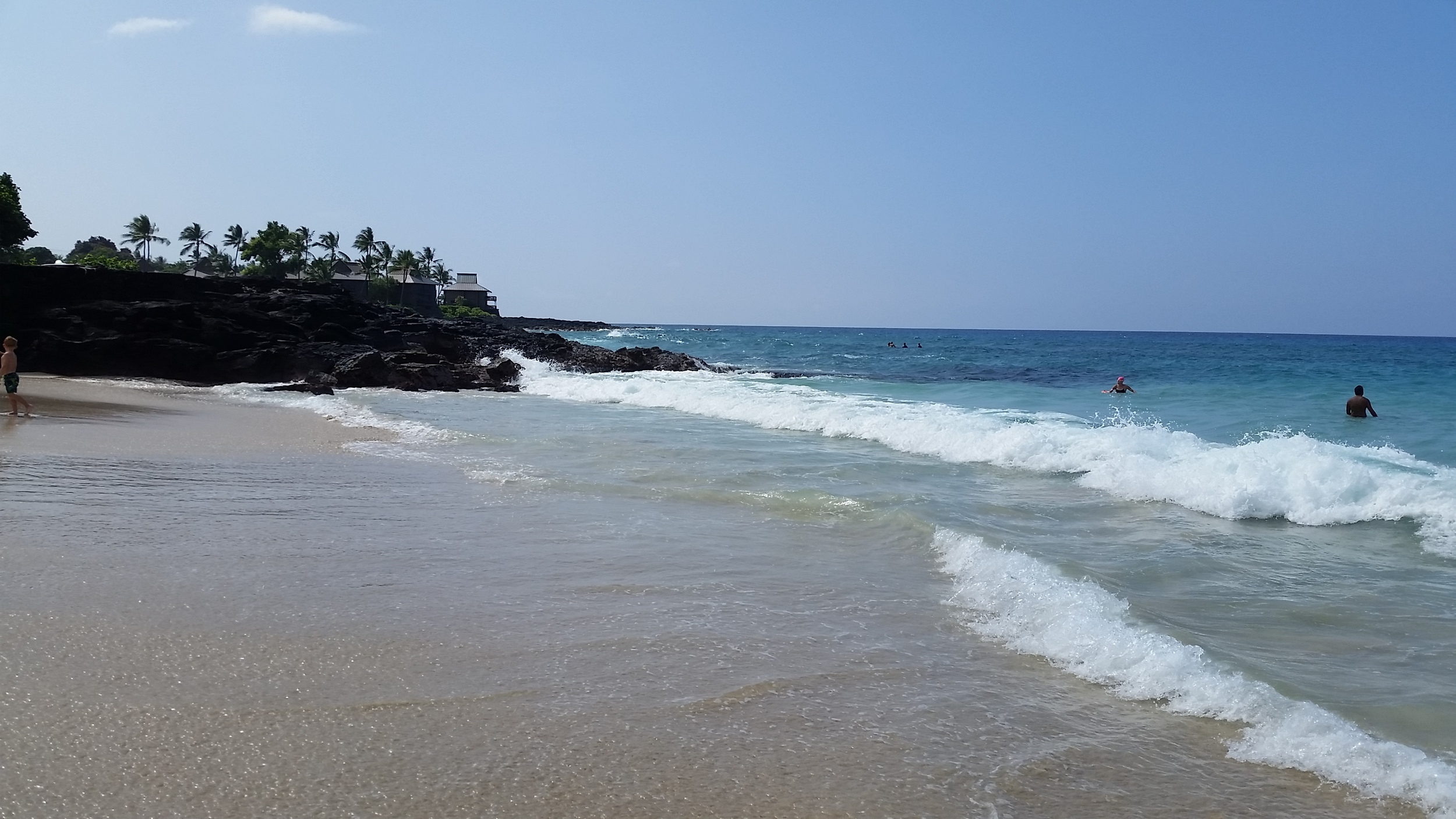 A shot of White Sands Beach. One of the few beaches situated on Ali'i Drive.