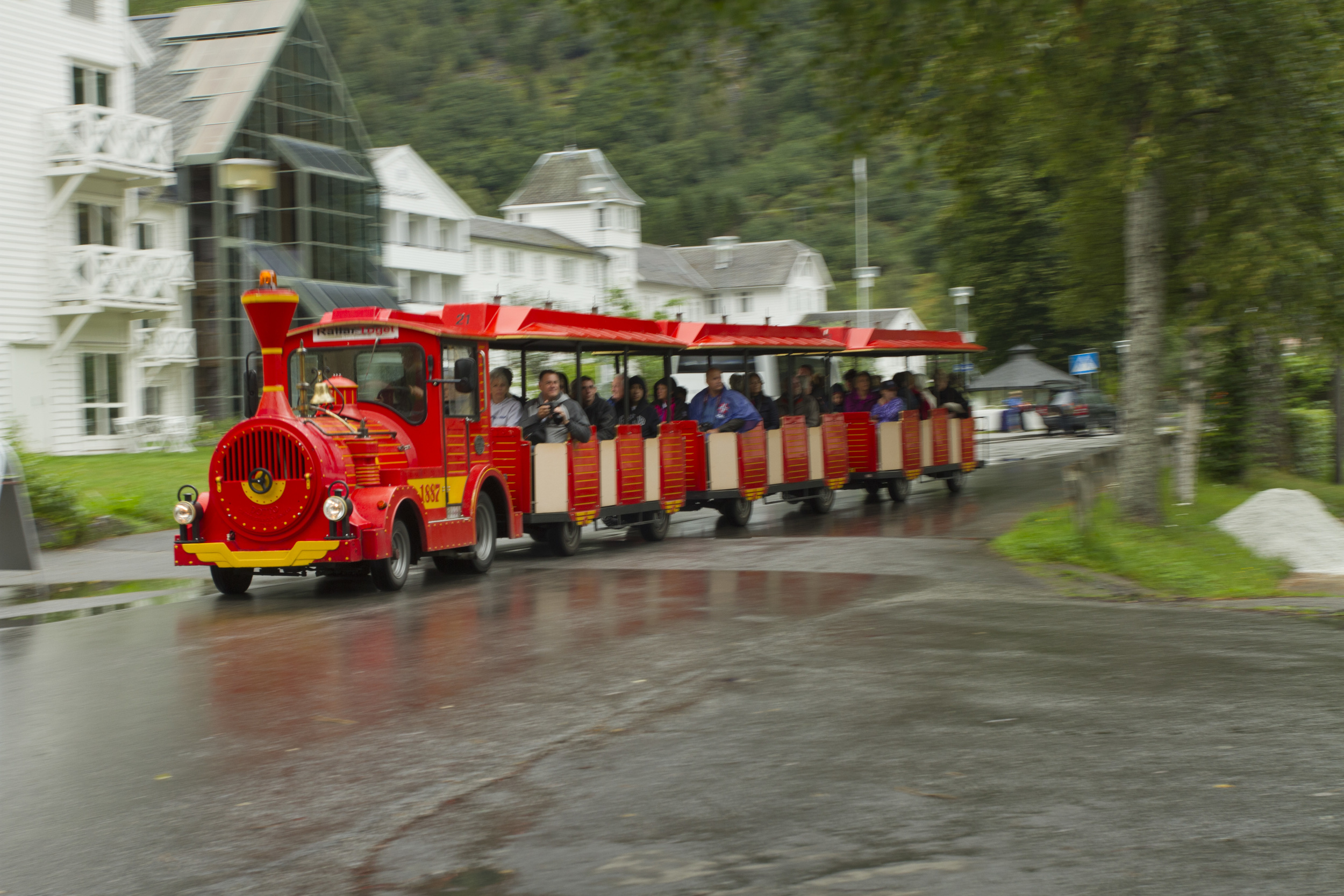 7. This final image is a reference to how tourism could damage Flam's sense of place. A bright red pad train transports sightseeing tourists to the next photo opportunity. The colour of the train dominates the photograph. By following its movement, whilst pressing the shutter button, I have blurred the scenery in the background, making it appear less significant. This is a reference to how tourism threats to harm Flam's unique, picturesque sense of place.