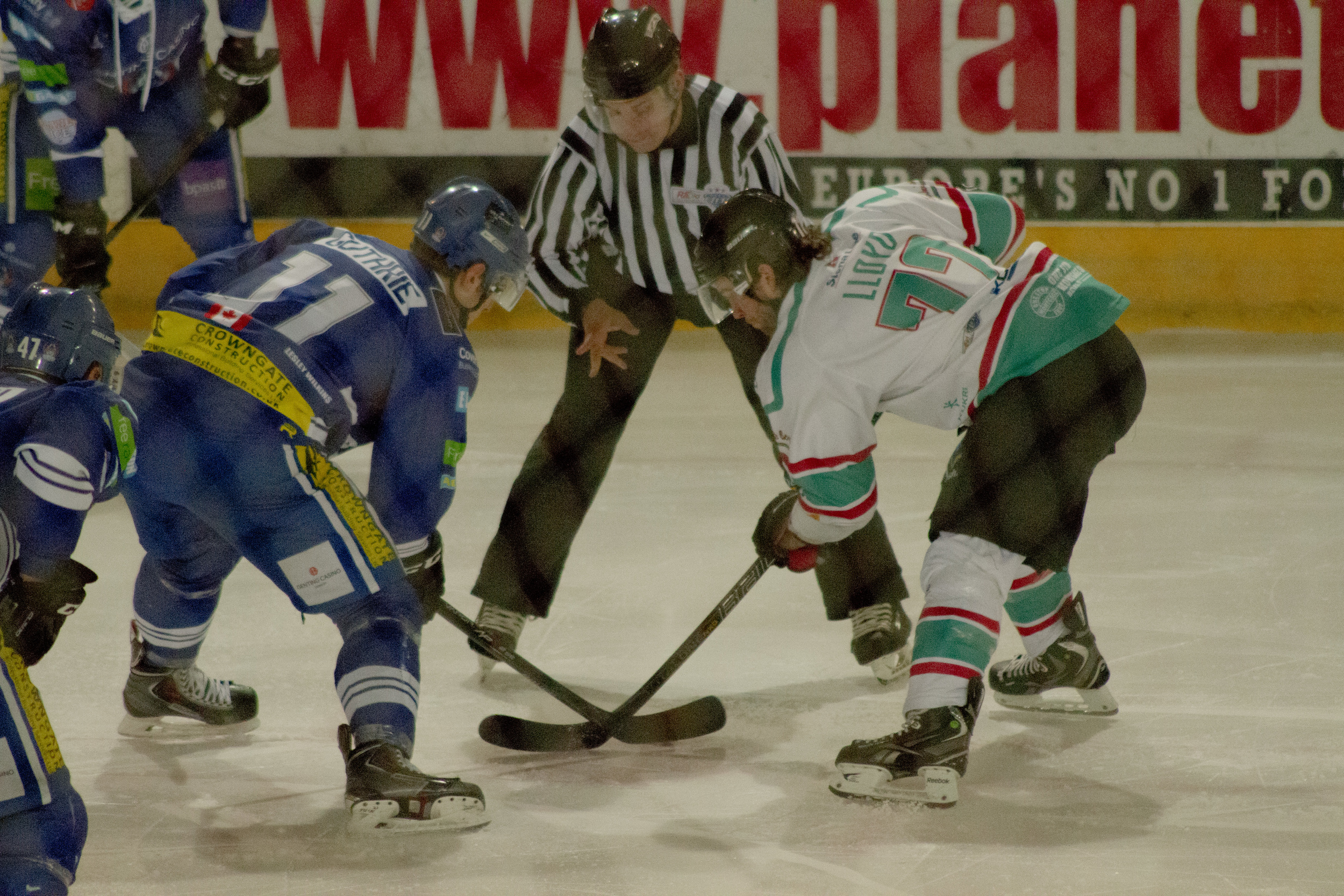 Face off. Both opposing players wait for the puck to be dropped in to start play.